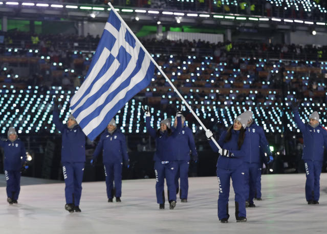 <p>Sophia Ralli carries the flag of Greece during the opening ceremony of the 2018 Winter Olympics in Pyeongchang, South Korea, Friday, Feb. 9, 2018. (AP Photo/Petr David Josek) </p>