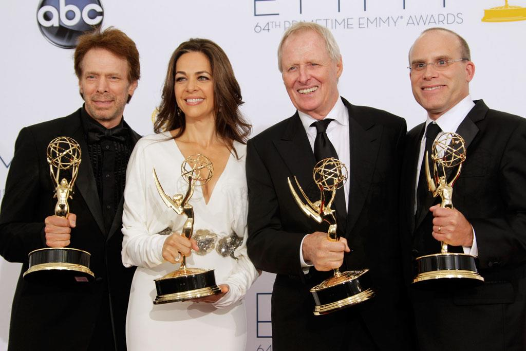 Producers Jerry Bruckheimer, Elise Doganieri, Bertram van Munster and Jonathan Littman pose in the press room at the 64th Primetime Emmy Awards at the Nokia Theatre in Los Angeles on September 23, 2012.