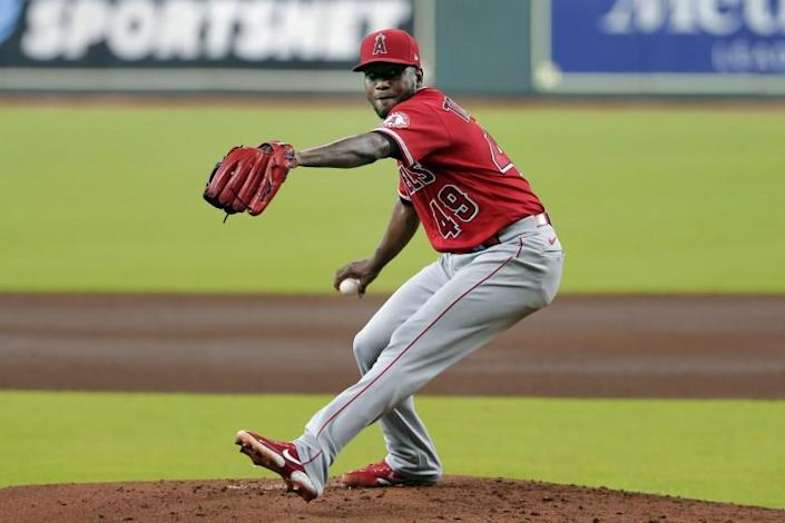"""Angels pitcher Julio Teheran throws against the Houston Astros during the first inning of the second game of a doubleheader Tuesday in Houston. <span class=""""copyright"""">(Michael Wyke / Associated Press)</span>"""
