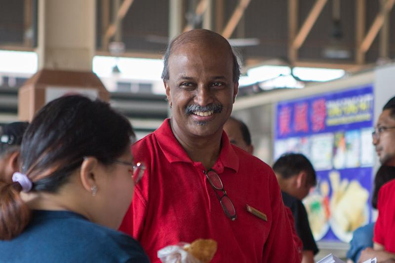 SDP chairman Paul Tambyah smiles during a party walkabout at the Ghim Moh Market and Food Centre on 3 November 2019. (PHOTO: Dhany Osman / Yahoo News Singapore)