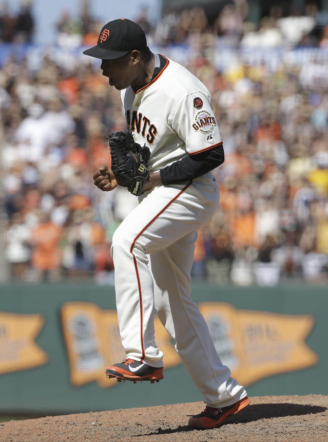 San Francisco Giants pitcher Santiago Casilla celebrates after the final out of the ninth inning in a baseball game against the Oakland Athletics in San Francisco, Sunday, July 26, 2015. The Giants won 4-3. (AP Photo/Jeff Chiu)