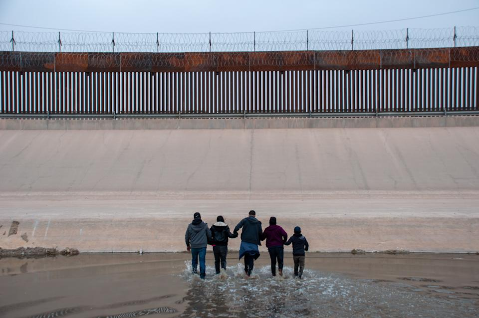 File photo taken on March 9, 2021 shows migrants attempting to cross the Rio Bravo river on the border between Mexico and the United States, from Ciudad Juarez, Mexico. A large increase in migrants pouring over the U.S. southern border has sparked yet another political fight in Washington.  (David Peinado/Xinhua via Getty Images)