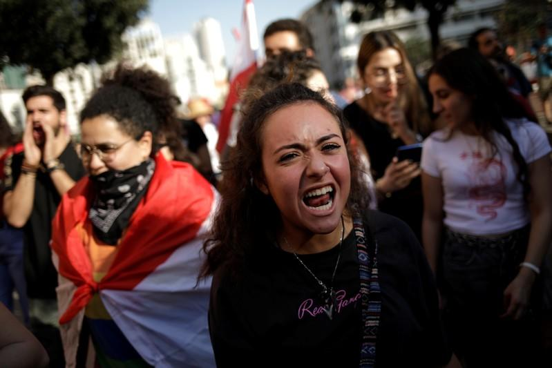 A protester shouts slogans at a demonstration organised by students during ongoing anti-government protests in Beirut
