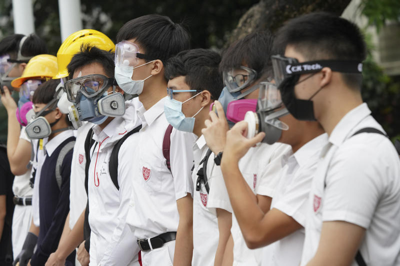 Students wearing gas masks and helmets stage a rally outside Queen's College in Hong Kong, on Monday, Sept. 2, 2019. Hong Kong has been the scene of tense anti-government protests for nearly three months. The demonstrations began in response to a proposed extradition law and have expanded to include other grievances and demands for democracy in the semiautonomous Chinese territory. (AP Photo)