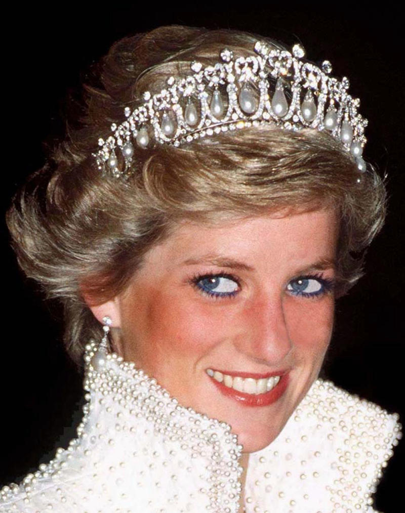 Princess Diana spotted graciously wearing her tiara and blue eyeliner. (Photo: Getty Images)