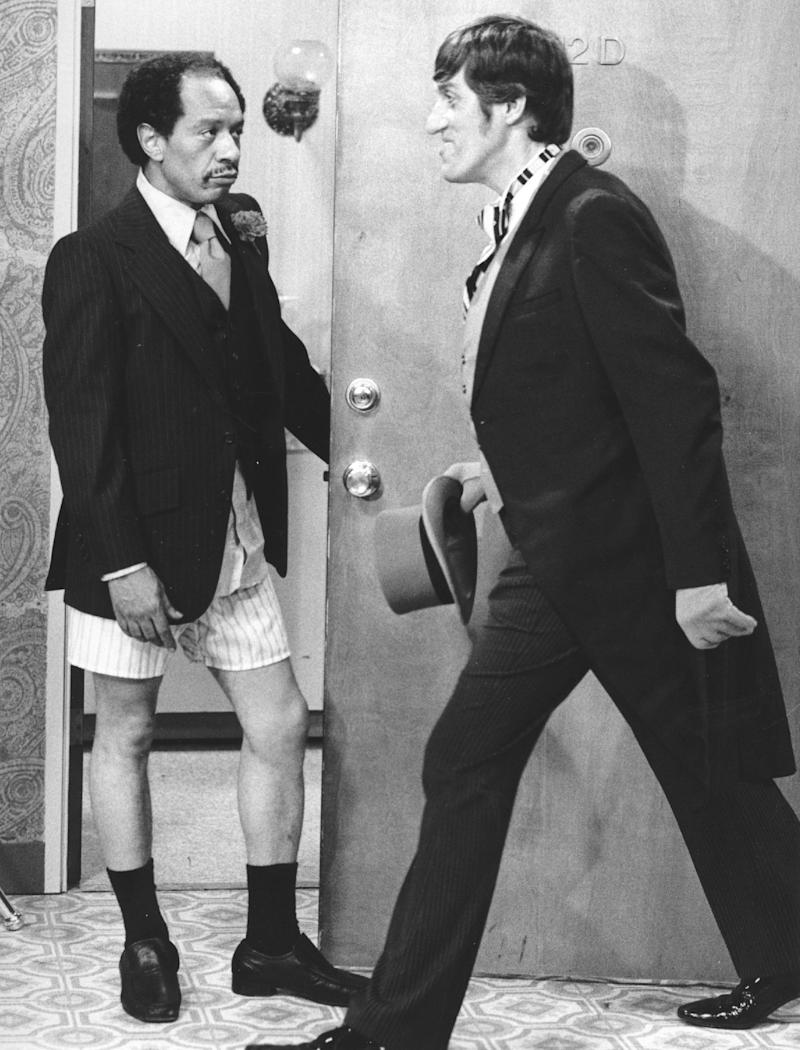 """FILE - In this 1977 file photo provided by CBS, Sherman Hemsley, left, and Paul Benedict star in an episode of """"The Jeffersons."""" Hemsley, the actor who made the irascible, bigoted George Jefferson of """"The Jeffersons"""" one of television's most memorable characters and a symbol for urban upward mobility, was found dead Tuesday, July 24, 2012 at his El Paso, Texas home. He was 74. (AP Photo/CBS, File)"""