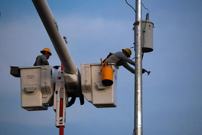Linemen like these in the town of Gurabo in November have been working hard to restore power across the Puerto Rico since Hurricane Maria slammed the island in September 2017