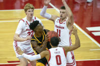 Arkansas-Pine Bluff's Alvin Stredic, center, goes up against Wisconsin's Steven Crowl (22), D'Mitrik Trice (0) and Micah Potter (11) during the first half of an NCAA college basketball game Friday, Nov. 27, 2020, in Madison, Wis. (AP Photo/Andy Manis)