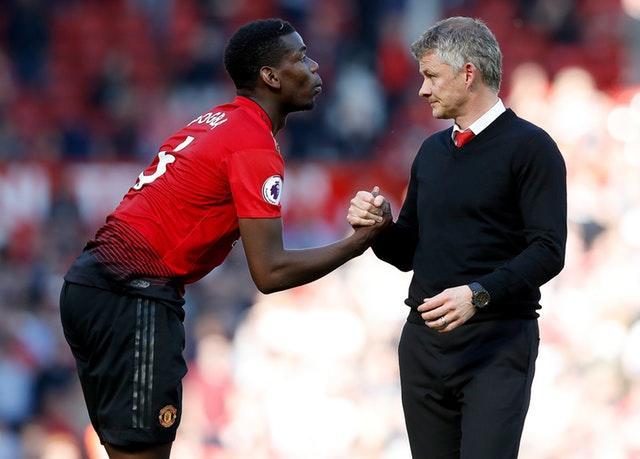 Manchester United manager Ole Gunnar Solskjaer, right, wants Paul Pogba, left, to stay at Old Trafford for one more season (Martin Rickett/PA)