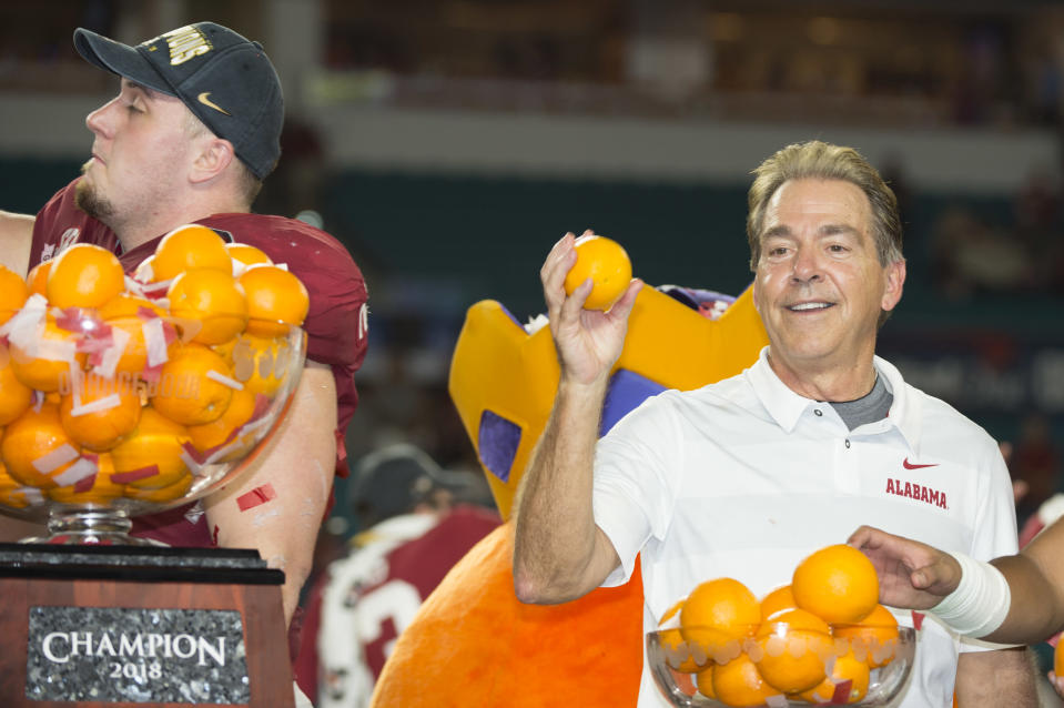 Alabama coach Nick Saban throws oranges to the crowd after the Crimson Tide beat Oklahoma in the CFP semifinal. (Getty)