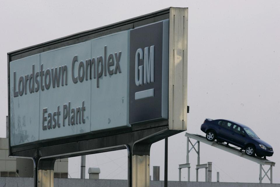A GM car rests on the roof of the General Motors Corp Lordstown complex east plant on Dec. 5, 2008, in Lordstown, Ohio. The worsening U.S. auto sales slump claimed another 2,000 workers Friday as GM announced layoffs at three more car factories. The company said it will cut shifts at car factories in Lordstown, Ohio; Orion Township, Michigan: and Oshawa, Ontario, starting in February due to slowing demand for their products. In Lordstown, 890 workers will go on indefinite layoff starting Feb. 2 when GM ends a third shift at the complex.