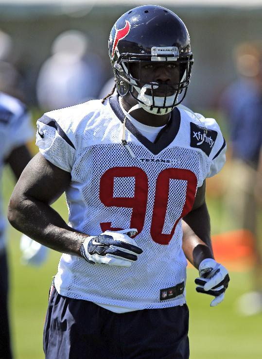 Houston Texans linebacker Jadeveon Clowney runs a drill during a joint practice between the Denver Broncos and the Texans on Tuesday, Aug. 19, 2014, in Englewood, Colo. (AP Photo/Jack Dempsey)