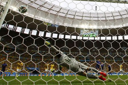 Robin van Persie of the Netherlands (4th R) scores a goal from a penalty kick past Brazil's goalkeeper Julio Cesar (12) during their 2014 World Cup third-place playoff at the Brasilia national stadium in Brasilia July 12, 2014. REUTERS/Dominic Ebenbichler