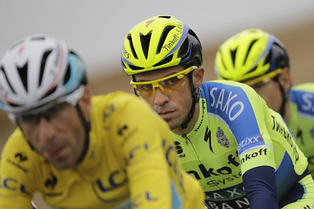 Spain's Alberto Contador, center, follows Italy's Vincenzo Nibali, wearing the overall leader's yellow jersey, as they ride in the pack during the sixth stage of the Tour de France cycling race over 194 kilometers (120.5 miles) with start in Arras and finish in Reims, France, Thursday, July 10, 2014. (AP Photo/Laurent Cipriani)