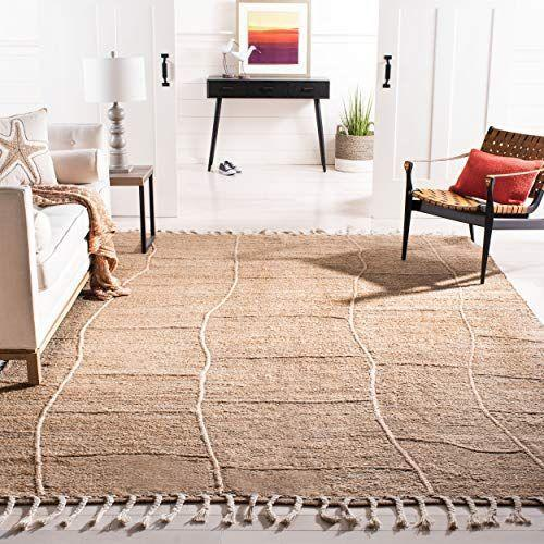 """<p><strong>NF105B Natural Premium Jute (5' x 8') Area Rug</strong></p><p>Safavieh</p><p><strong>$124.56</strong></p><p><a href=""""https://www.amazon.com/dp/B07NPJ5PWT?tag=syn-yahoo-20&ascsubtag=%5Bartid%7C10069.g.34043814%5Bsrc%7Cyahoo-us"""" rel=""""nofollow noopener"""" target=""""_blank"""" data-ylk=""""slk:Shop Now"""" class=""""link rapid-noclick-resp"""">Shop Now</a></p><p>This stellar Amazon find is another favorite of Welch's and works for a variety of design tastes. The handwoven rug is made with naturally softened fibers for a delightful experience. </p>"""