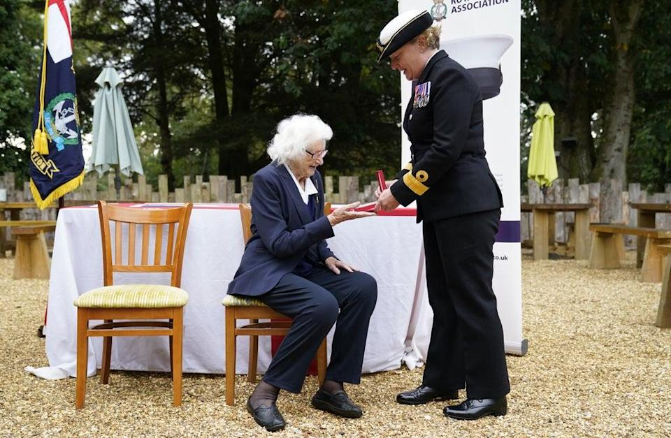 Mrs Cockayne receives the Legion d'honneur from Royal Navy Commodore Judith 'Jude' Terry (Andrew Matthews/PA) (PA Wire)
