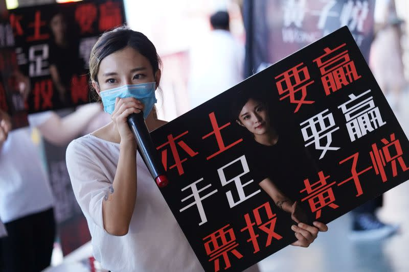 Wong Ji-yuet campaigns for the primary election aimed at selecting democracy candidates for the September election, in Hong Kong