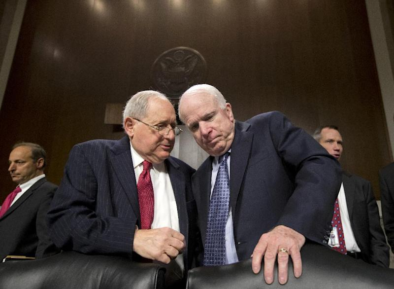 Senate Armed Services Committee Chairman Sen. Carl Levin, D-Mich., left, talks with committee member Sen. John McCain, R-Ariz., on Capitol Hill in Washington, Tuesday, April 9, 2014, prior to the start of the committee's hearing focusing on the Korean peninsula as it reviews defense authorization requests for fiscal year 2014. (AP Photo/J. Scott Applewhite)