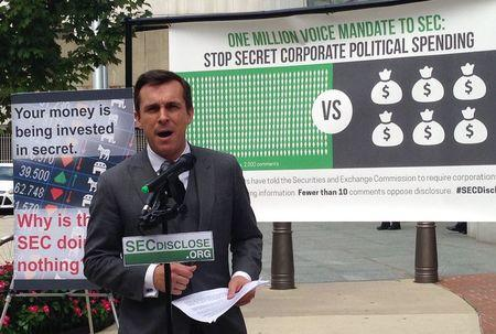 Columbia Law Professor Jackson speaks in front of Securities and Exchange Commission headquarters in Washington