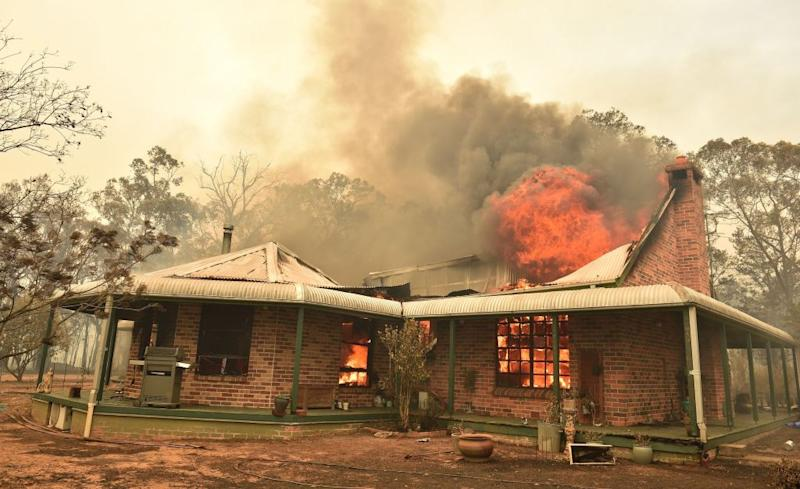 A property burns from bushfires in Balmoral, 150 kilometres southwest of Sydney, on December 19, 2019.