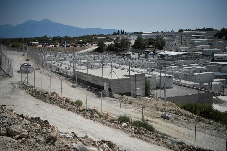 Double barbed wire surrounds the 12,000 square metre camp on the island of Samos (AFP/LOUISA GOULIAMAKI)