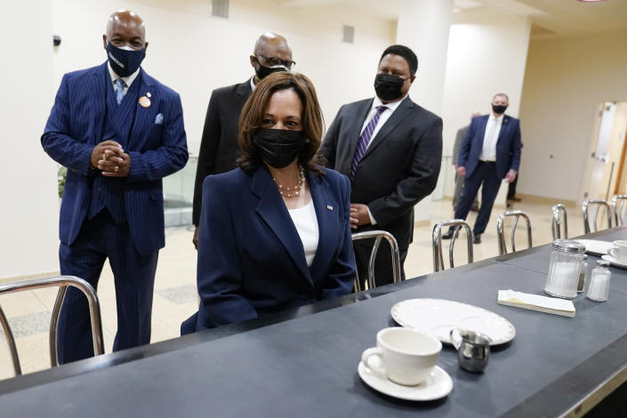 Vice President Kamala Harris sits at the lunch counter where four Black students sat down at Woolworth's lunch counter in Greensboro, N.C., and ordered coffee, during her visit to the International Civil Rights Center and Museum, Monday, April 19, 2021, in Greensboro, N.C. With Harris are Melvin Skip Alston-Guilford, County Board of Commissioners, Rev. Anthony Spearman and museum director John Swain. Harris is sitting in the same chair that Rosa Parks sat in during a visit in 1995. (AP Photo/Carolyn Kaster)
