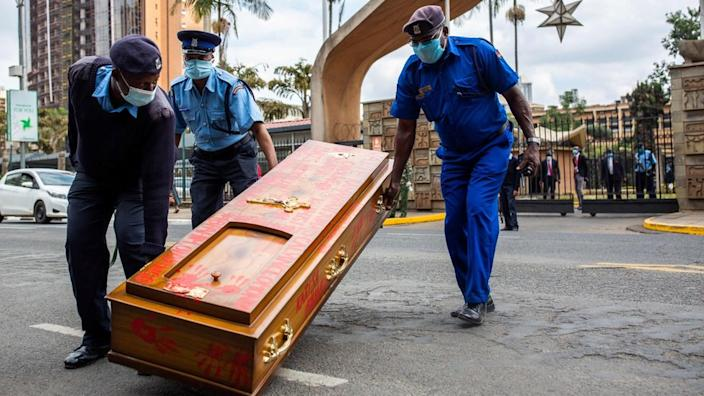 On Tuesday police in Kenya's capital Nairobi drag away an empty coffin left by protesters at a march against police brutality...