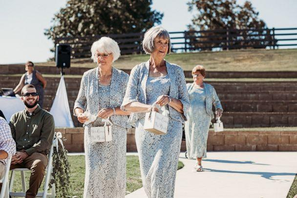 PHOTO: Wanda Grant and Betty Brown walk down the aisle at their granddaughter's Tennessee wedding September 22. (Natalie Caho Photography)