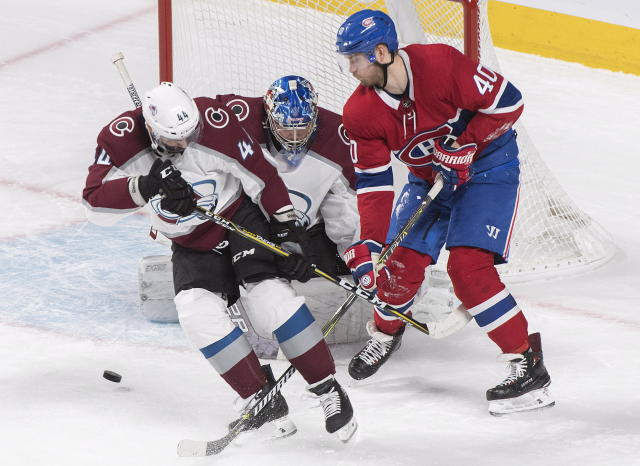 Montreal Canadiens' Joel Armia (40) moves in on Colorado Avalanche's Semyon Varlamov as Avalanche's Mark Barberio defends during the second period of an NHL hockey game Saturday, Jan. 12, 2019, in Montreal. (Graham Hughes/The Canadian Press via AP)