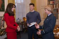 <p>Kate wore the separates again when she received a book from Air Commodore Dawn McCafferty in London. </p>