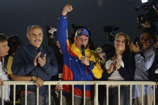 """<p>Miranda state governor Henriques Capriles Radonski waves to supporters after wining the re-election in Caracas on December 26, 2012. President Hugo Chavez's top rival survived a tough test Sunday, winning re-election as governor, but he allowed that losses in other state-level races were a """"tough moment"""" for Venezuela's opposition.</p>"""