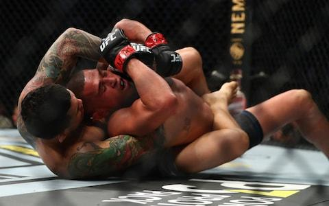 Ferreira tries to hold Pettis during their fight in Las Vegas - Credit: MARK J REBILAS/USA TODAY SPORTS