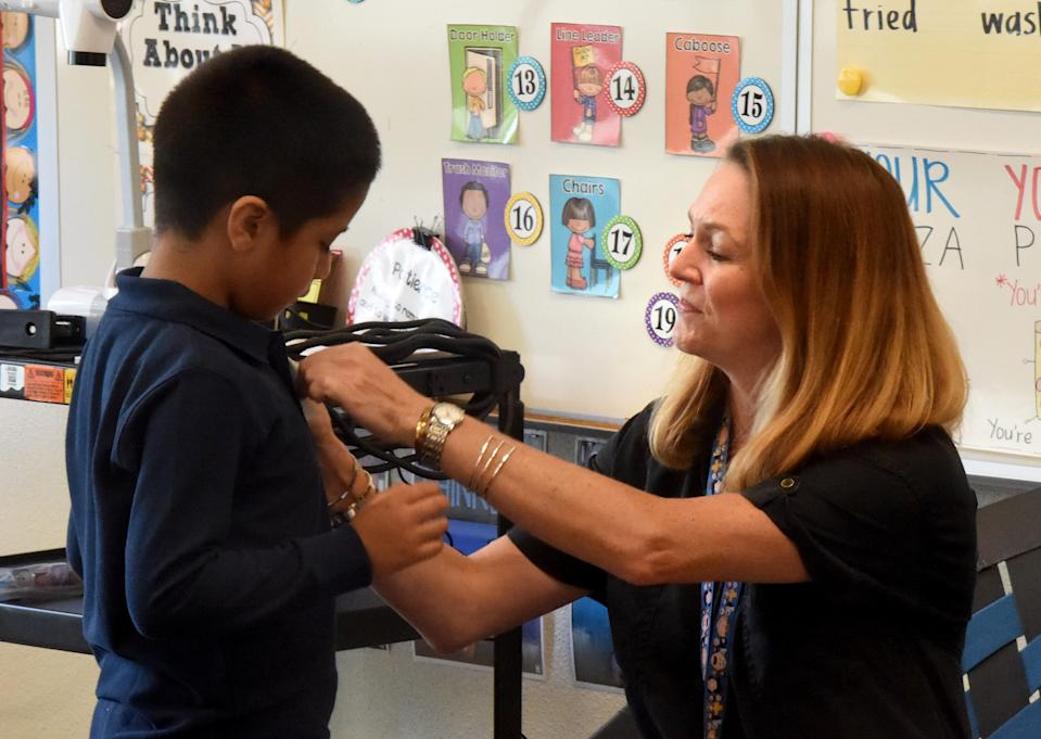 LONG BEACH, CA - AUGUST 28: Ms. Quan gives her first grade students name tags on the first day of school at McKinley Elementary School in Long Beach on Wednesday, August 28, 2019. (Photo by Brittany Murray/MediaNews Group/Long Beach Press-Telegram via Getty Images)