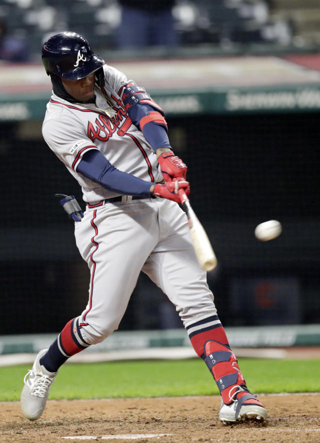 Atlanta Braves' Ronald Acuna Jr. hits a two-run double off Cleveland Indians relief pitcher Oliver Perez in the ninth inning during the second game of a baseball doubleheader, Saturday, April 20, 2019, in Cleveland. Josh Donaldson and Ozzie Albies scored on the play. Atlanta won 8-7. (AP Photo/Tony Dejak)