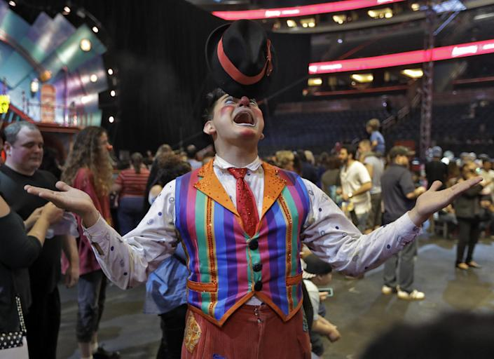 """A Ringling Bros. and Barnum & Bailey clown balances a hat on his nose during a pre show for fans Saturday, Jan. 14, 2017, in Orlando, Fla. The Ringling Bros. and Barnum & Bailey Circus will end the """"The Greatest Show on Earth"""" in May, following a 146-year run of performances. Kenneth Feld, the chairman and CEO of Feld Entertainment, which owns the circus, told The Associated Press, declining attendance combined with high operating costs are among the reasons for closing. (AP Photo/Chris O'Meara)"""