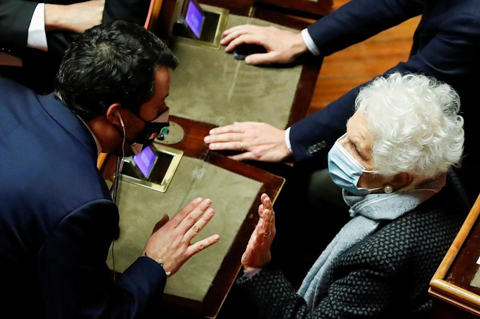 Leader of Italy's far-right League party Matteo Salvini speaks to Senator Liliana Segre ahead of a confidence vote at the upper house of parliament, in Rome, Italy, January 19, 2021. REUTERS/Yara Nardi/Pool (Photo: Yara Nardi / Reuters)