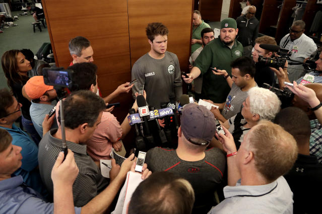 New York Jets quarterback Sam Darnold, who was selected third overall in the first round of the NFL draft, speaks to reporters at NFL football rookie camp, Friday, May 4, 2018, in Florham Park, N.J. (AP Photo/Julio Cortez)