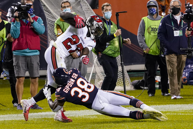 Tampa Bay Buccaneers running back Ronald Jones (27) had a touchdown taken away on an odd call. (AP Photo/Charles Rex Arbogast)