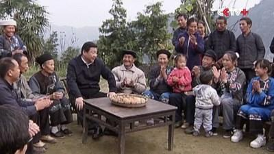 photo of President Xi Jinping with people in poor region (PRNewsfoto/CCTV+)