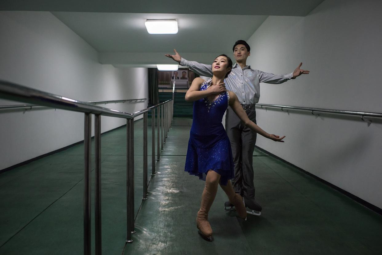 Figure skaters Nam Yong-Myong (left) and Choe Min pose for a portrait in Pyongyang. The skaters were performing at the Paektusan Prize international figure skating festival.