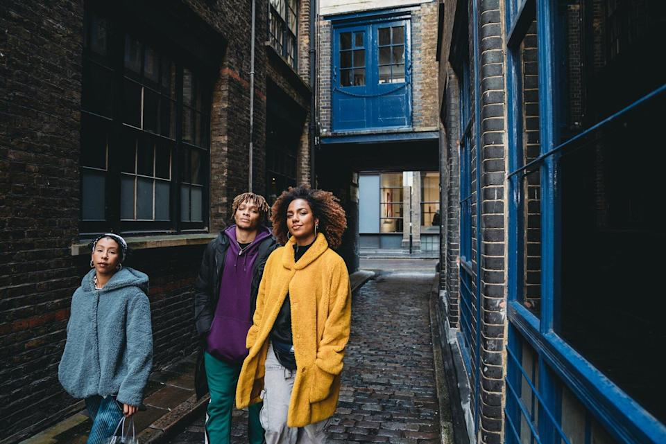 Three young people walking in Shoreditch, London