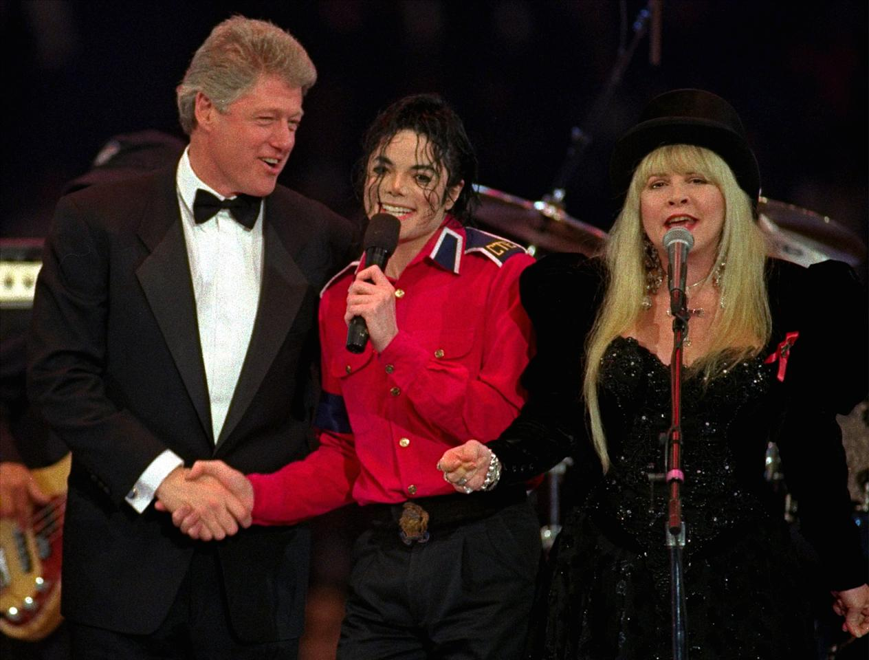 "President-elect Clinton joins Michael Jackson and Stevie Nicks, of Fleetwood Mac, as they sing ""Don't Stop"" for the grand finale of Tuesday night's Presidential Gala at the Capital Centre in Landover, Md., January 19, 1993. (AP Photo)"