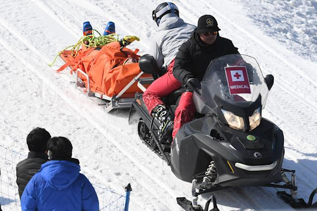 Christopher Del Bosco is transported off the hill on Wednesday. (Getty Images)