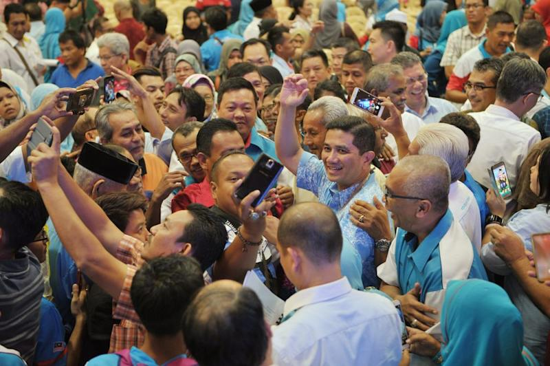 PKR deputy president Datuk Seri Mohamed Azmin Ali waves to the crowd during the gathering with members in Seberang Perai Setember 13, 2018. ― Picture by KE Ooi
