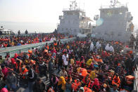 Rohingya refugees wait on naval ships to be transported to an isolated island in the Bay of Bengal, in Chittagong, Bangladesh, Tuesday, Dec. 29, 2020. Officials in Bangladesh sent a second group of Rohingya refugees to the island on Monday despite calls by human rights groups for a halt to the process. The Prime Minister's Office said in a statement that more than 1,500 Rohingya refugees left Cox's Bazar voluntarily under government management. Authorities say the refugees were selected for relocation based on their willingness, and that no pressure was applied on them. But several human rights and activist groups say some refugees have been forced to go to the island, located 21 miles (34 kilometers) from the mainland. (AP Photo/Mahmud Hossain Opu)