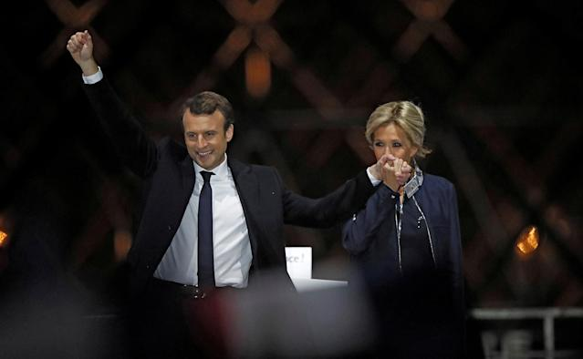 <p>French president-elect Emmanuel Macron celebrates on stage with wife Brigitte Trogneux during his victory rally near the Louvre museum in Paris, May 7, 2017. (Christian Hartmann/Reuters) </p>