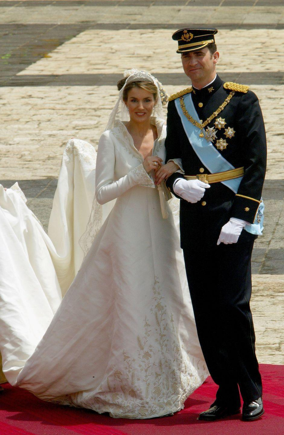 "<p><a href=""https://www.townandcountrymag.com/society/tradition/g10297690/queen-letizia-style/"" rel=""nofollow noopener"" target=""_blank"" data-ylk=""slk:Queen Letizia Ortiz of Spain"" class=""link rapid-noclick-resp"">Queen Letizia Ortiz of Spain</a> married King Felipe in the <span class=""redactor-unlink"">Cathedral Santa María la Real de la Almudena</span> in Madrid, on May 22, 2004. Her wedding gown, designed by Manuel Pertegaz, consists of natural silk, woven with silver and gold thread, and a 15-foot train.</p>"