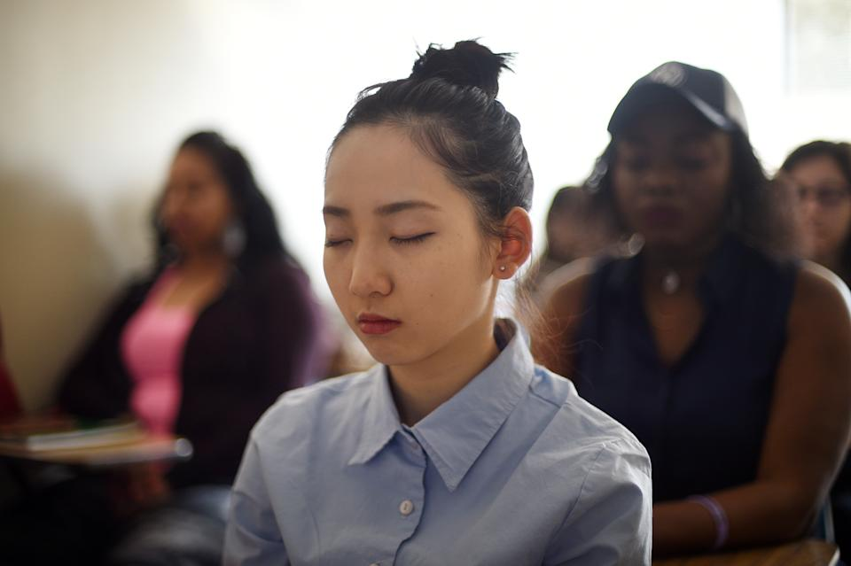 GERMANTOWN, MD - MARCH 24: Student Helen Huang, 20, participates in an exercise of silence and relaxation during a class by Joanne Bagshaw, professor of psychology, at Montgomery College in Germantown, MD, March 24, 2016. The exercise, which usually takes place for about 5 minutes prior class begin, is intended to help students to reduce stress and to focus easier on their class work. (Photo by Astrid Riecken For The Washington Post via Getty Images)