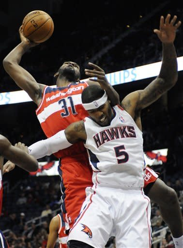 Washington Wizards' Chris Singleton (31) brings down a rebound over Atlanta Hawks' Josh Smith (5) in the first half of an NBA basketball game at Philips Arena in Atlanta, Wednesday, Nov. 21, 2012. (AP Photo/David Tulis)