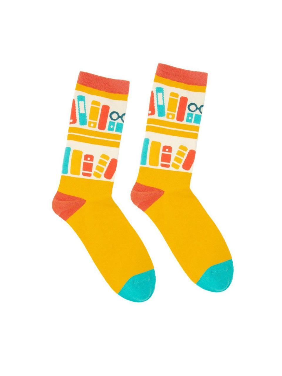 "<p><strong>Out of Print</strong></p><p>outofprint.com</p><p><strong>$12.00</strong></p><p><a href=""https://outofprint.com/collections/socks/products/bookshelf-socks"" rel=""nofollow noopener"" target=""_blank"" data-ylk=""slk:Shop Now"" class=""link rapid-noclick-resp"">Shop Now</a></p><p>Let your bibliophile show off their hobby wherever they go with these fun printed socks. </p>"